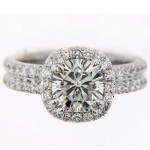 Matthew Ryan Designs 14KT White Gold Halo Engagement Ring with 7.50 MM Cushion cut Moissanite Center Stone MRD1031